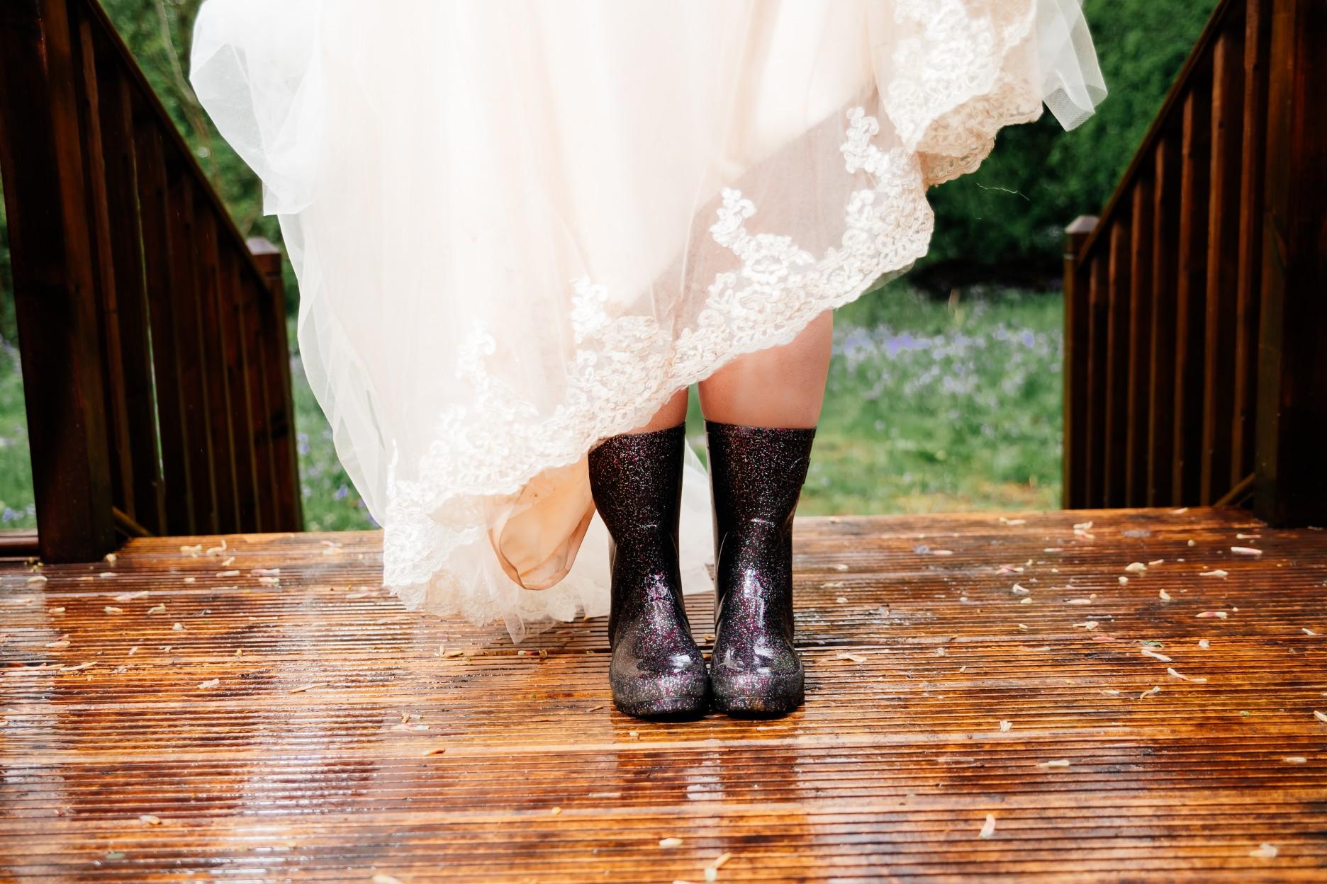 bride in wellies - rainy wedding - rain wedding advice - fun wedding planning - wedding planning blog - rain wedding photos