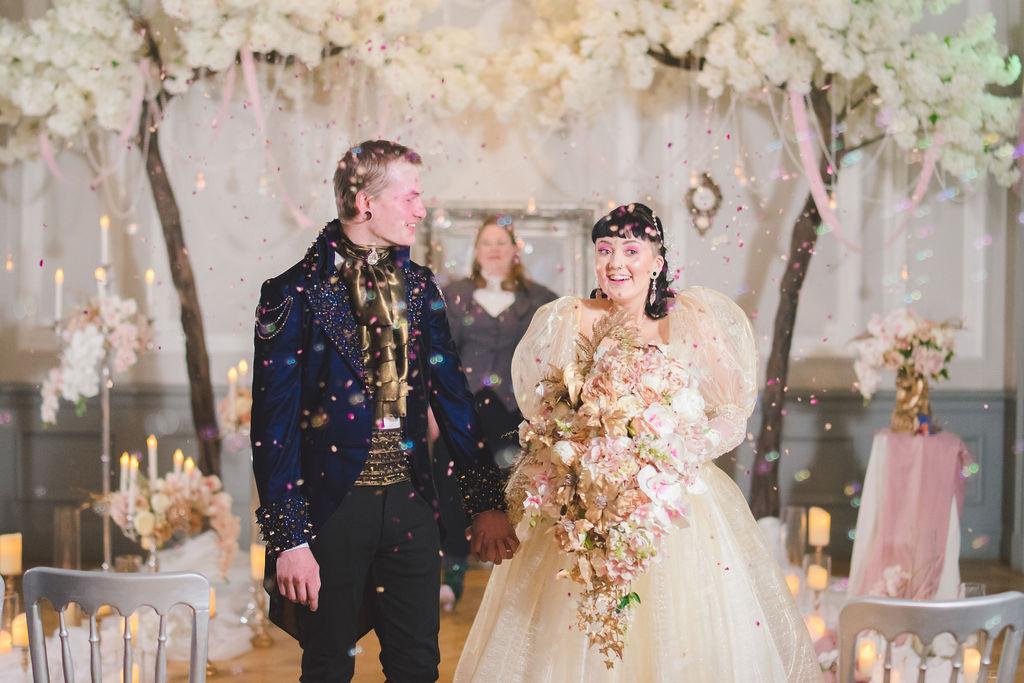 Wedding ceremony confetti photo with couple