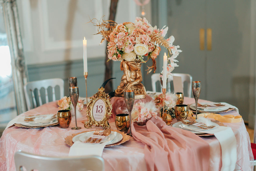 Dramatic themed wedding table centrepiece with goblin and ornate gold detailing - movie themed wedding tablescape by finishing flourishes