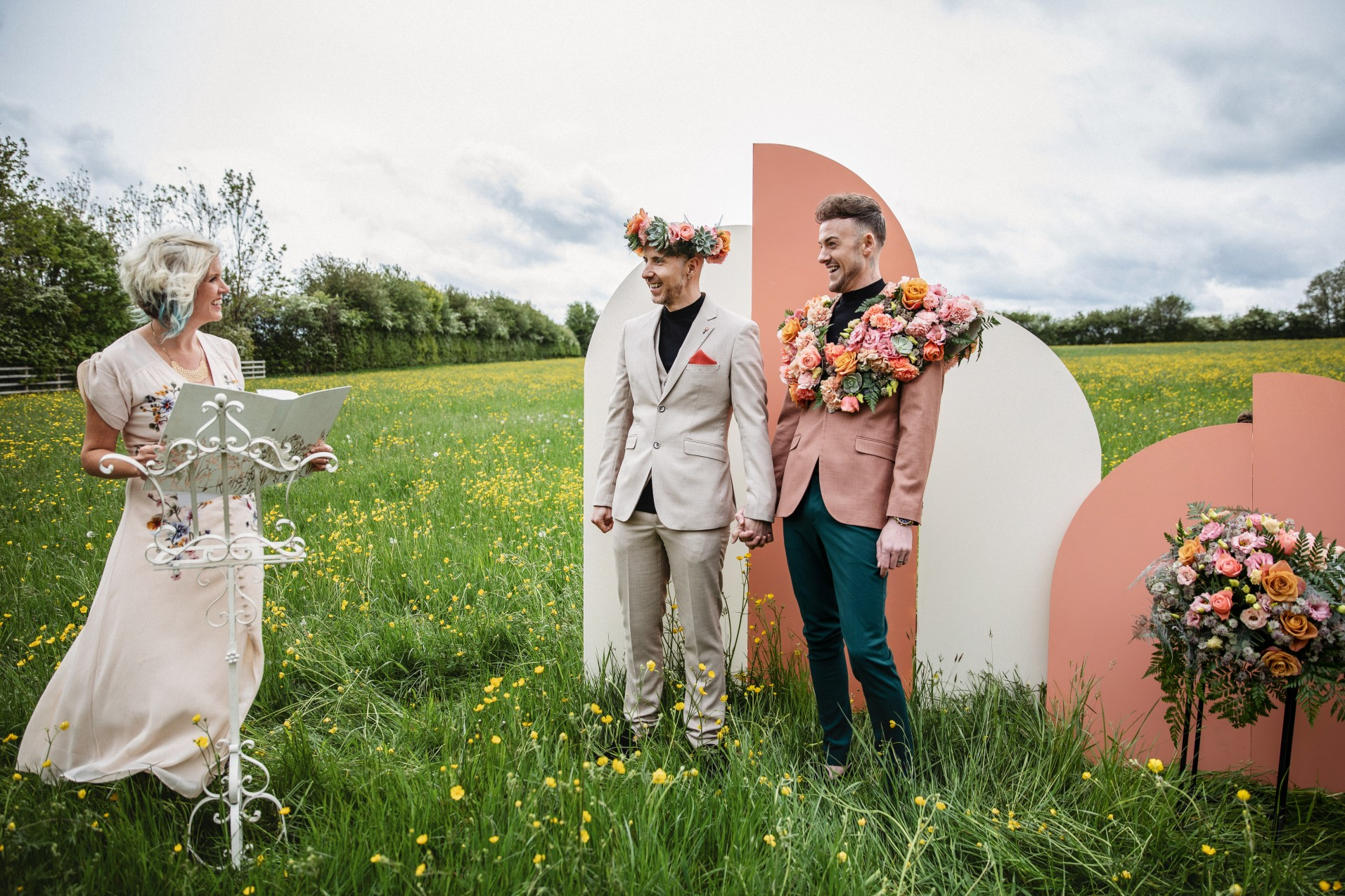 outdoor wedding ceremony - gay celebrant ceremony - gay wedding ideas - retro wedding backdrop - grooms style ideas - colourful grooms suit