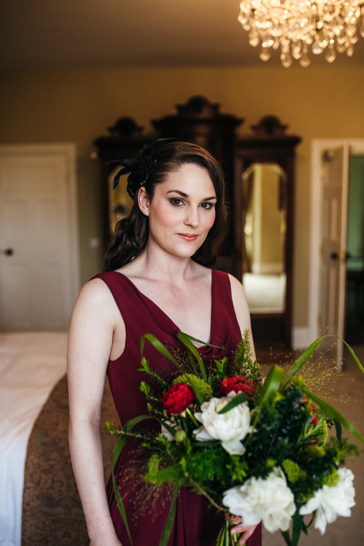 burgundy bridesmaids dress - white and red wedding bouquet - bridesmaids hair accessories