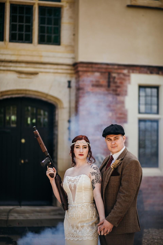 peaky blinders wedding - vintage wedding - 1920s wedding - themed wedding inspiration - vintage wedding dress - bride with gun