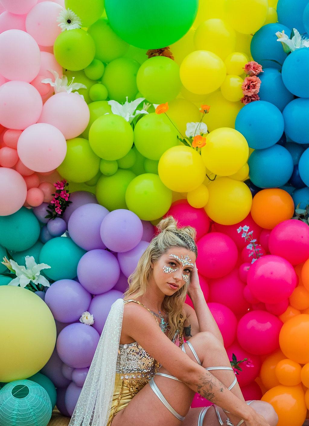 sparkly festival wedding - rainbow wedding backdrop - colourful wedding balloons - festival bride - festival wedding wear - unique bridal wear