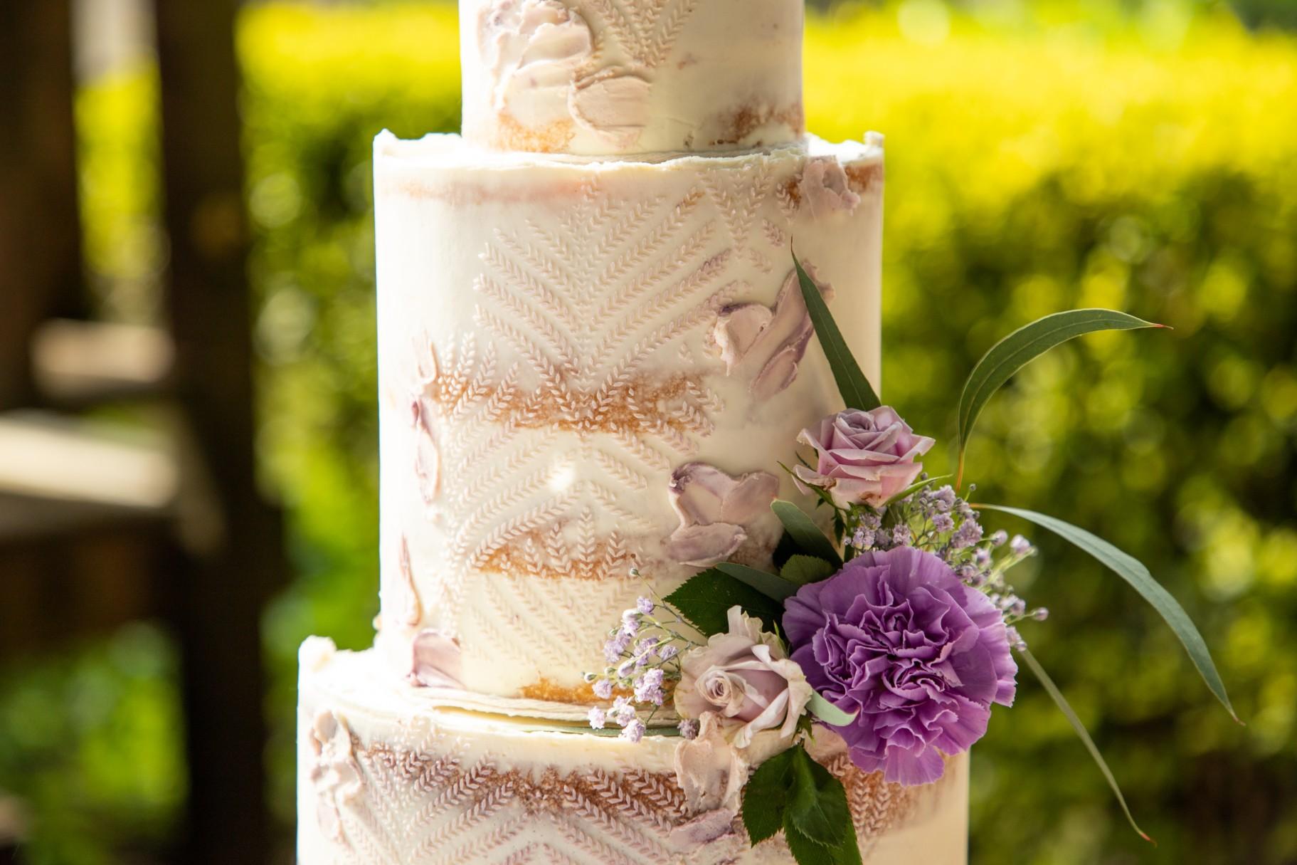 bohemian wedding cake with purple flower - unique wedding cake