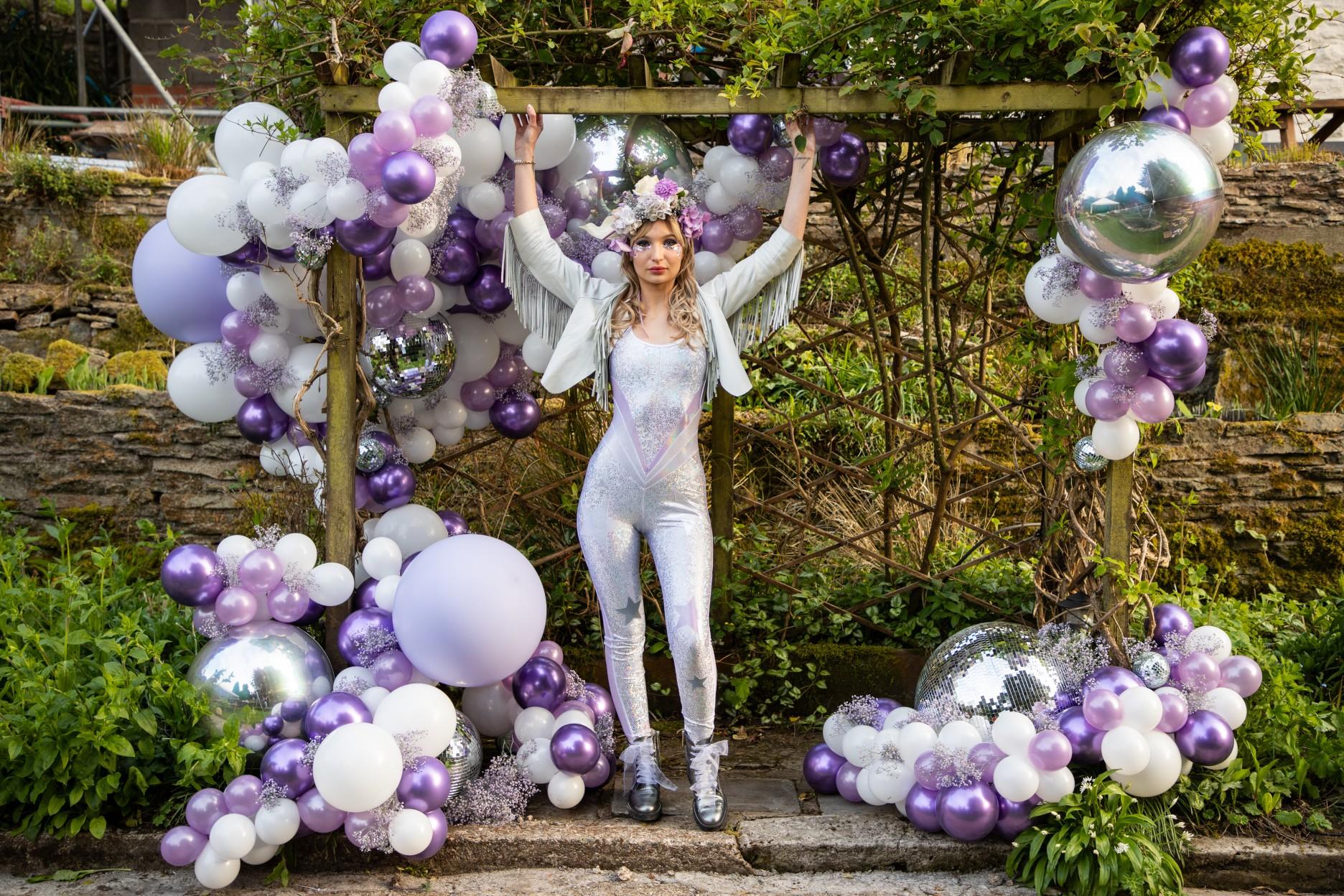 unique wedding balloons - unique wedding decoration - purple wedding - wedding balloon display - modern festival wedding - unique wedding wear - wedding jumpsuit - wedding catsuit - festival bride - unique wedding wear