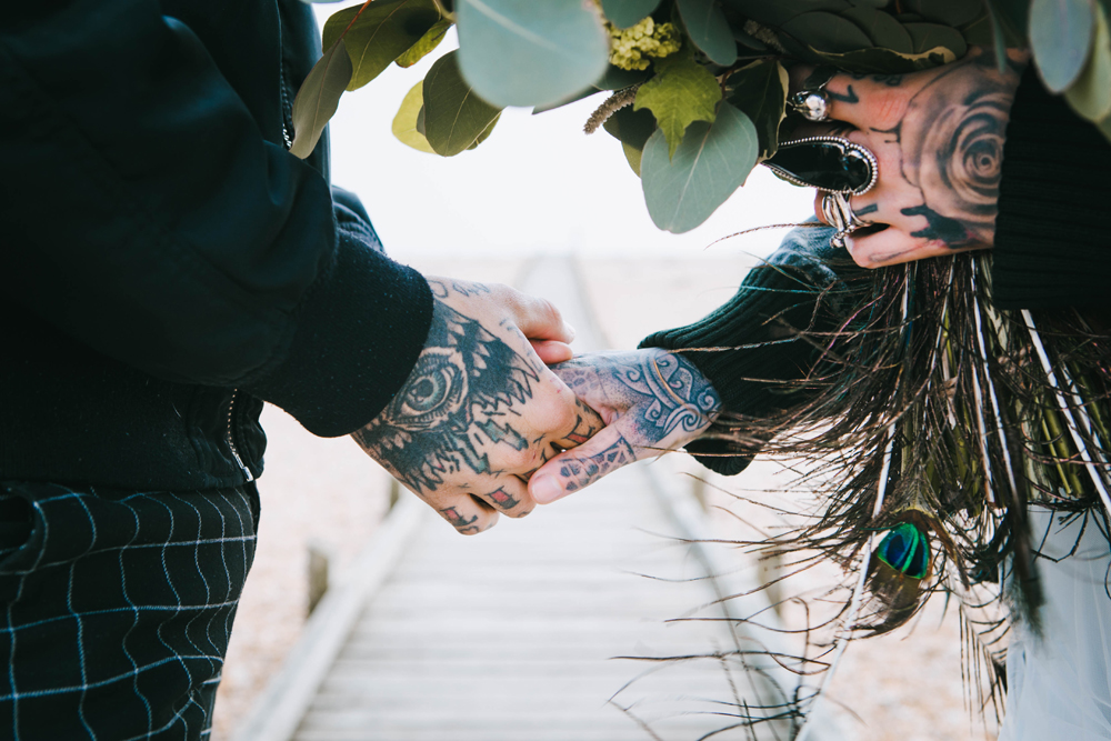 tattooed couple wedding - peacock wedding flowers - tattooed bride - alternative micro wedding ideas - unconventional wedding