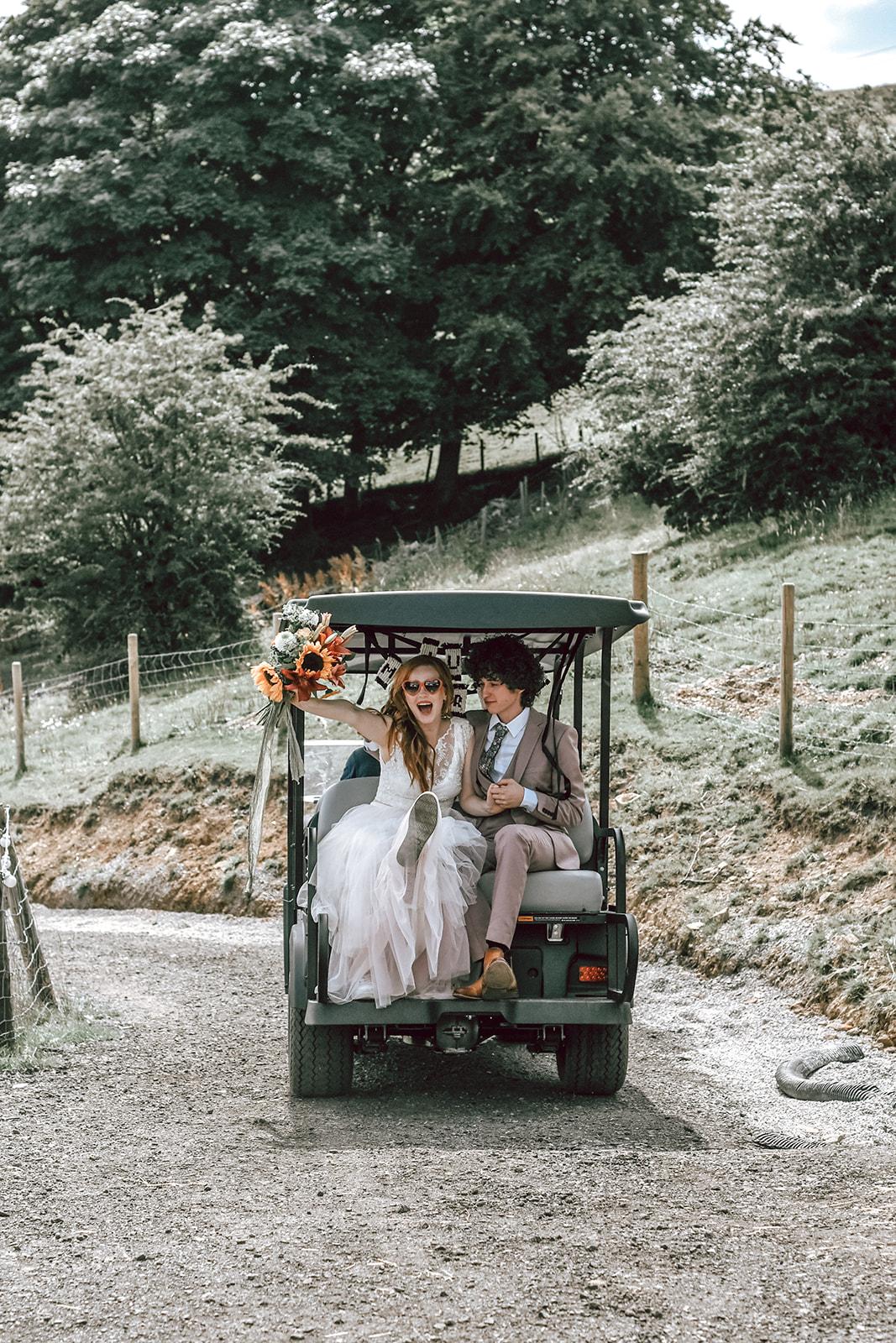 rustic festival wedding - wedding golf buggy - fun wedding ideas