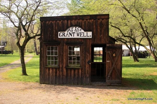 A historic oil building on the grounds of the Drake Well Museum.