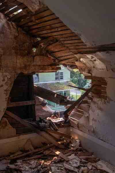 Hole in the roof at a home in Yellow Dog Village near Kittanning, PA