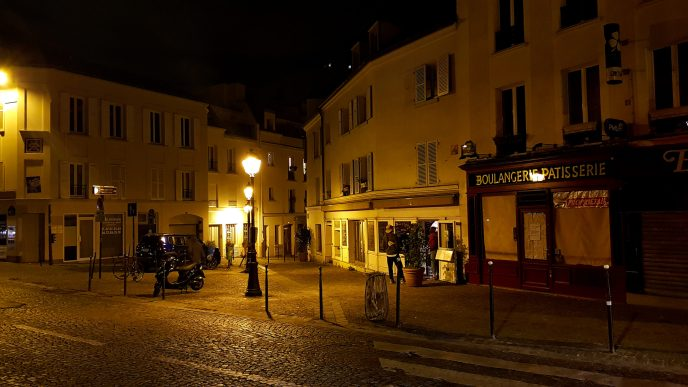 A boulangerie and patisserie at night