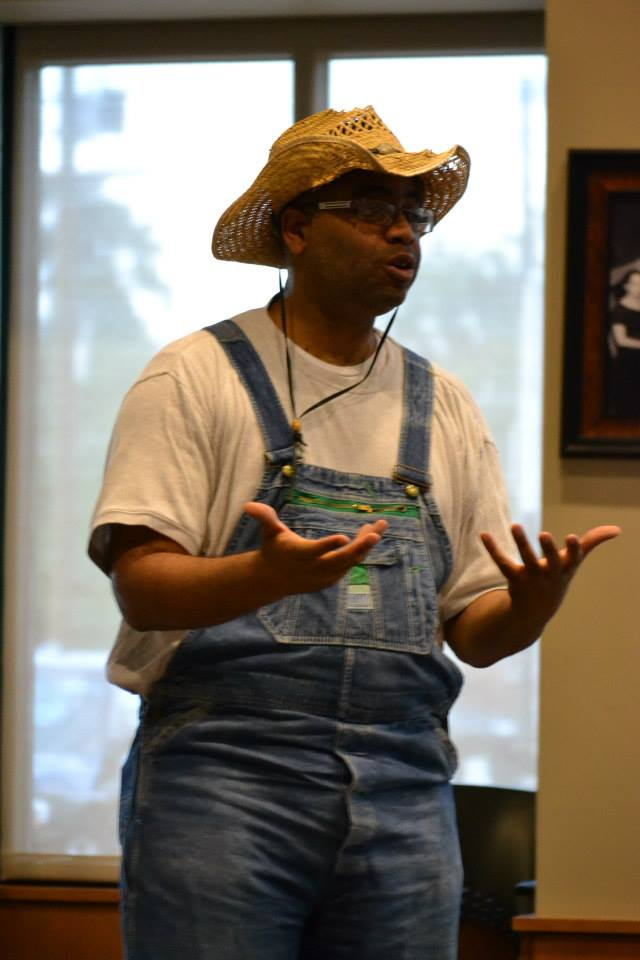 "Adrian Miller speaks in costume as a sharecropper at the book launch for ""Soul Food,"" 8/17/2013 Denver Public Library"