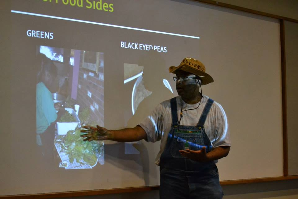 In costume as a sharecropper for the Rural South theme of the first floor of the event, author Adrian Miller breaks it down about greens and black-eyed peas. Denver Public Library, 8/17/2013
