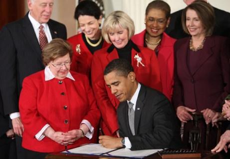Obama signs the Lily Ledbetter Fair Pay Act. photo: AP/Ron Edmonds