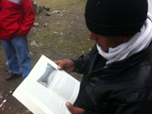 "Communal authority of Huaychao with the book, ""The Corner of the Living."""