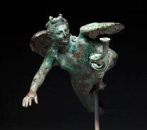 Eros lamp holder, Hellenistic, early 1st century B.C., bronze, Dallas Museum of Art, The Eugene and Margaret McDermott Art Fund, Inc., in honor of Anne Bromberg's 30th anniversary with the Dallas Museum of Art