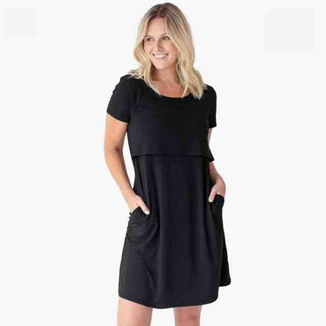blonde woman standing in black maternity and nursing nightgown that doubles as a daytime dress