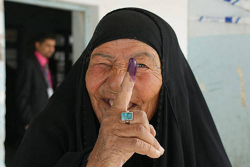 Female voter displays her purple finger tips after casting ballots at an elementary school in Nasiriyah (Iraq's fourth largest city) March 7 2010. The heavy purple dye reduces attempts of double-voting fraud. Source: DVIDSHUB on Flickr