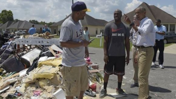 Obama visits with residents of Louisiana (Source: BBC)