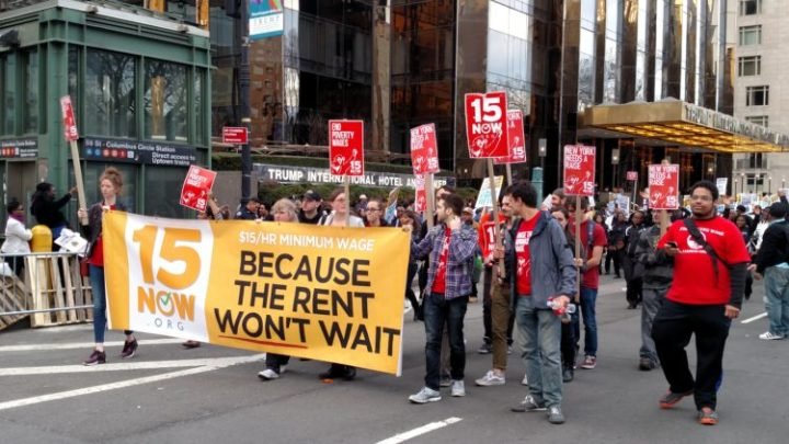 Protesters in support of a $15 federal minimum wage at a NYC rally