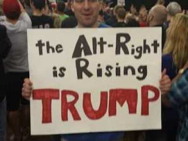 A member of the Alt RIght holds a Trump sign at a rally. (Source: Jesse Walker)