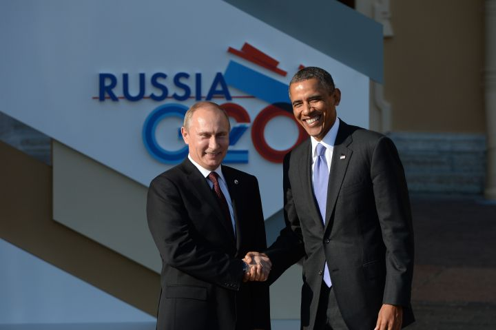 ST. PETERSBURG, RUSSIA - SEPTEMBER 05: In this handout image provided by Host Photo Agency, Russian President Vladimir Putin (L) greets U.S. President Barack Obama at the G20 summit on September 5, 2013 in St. Petersburg, Russia. The G20 summit is expected to be dominated by the issue of military action in Syria while issues surrounding the global economy, including tax avoidance by multinationals, will also be discussed during the two-day summit. (Photo by Ramil Sitdikov/Host Photo Agency via Getty Images)