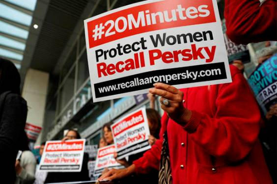 """Protestors and activists with signs that read """"#20Minutes"""", referring to the letter released by Brock Turner's father that referred to his son's sexual assault. Many felt that Judge Persky should have been recalled based on his decision for the verdict. (Credit: Reuters/Stephen Lam)"""