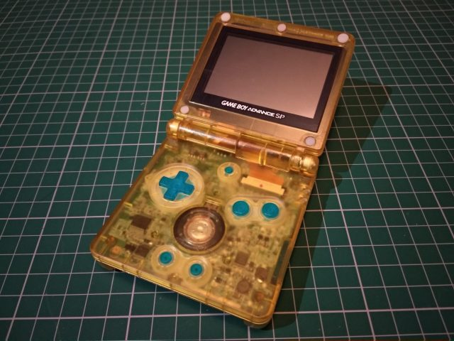 A Transparent Yellow Gameboy Advance SP Shell