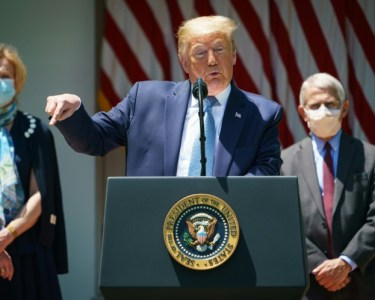 US President Donald Trump, flanked by senior helath officials, launches the high-powered 'Operation Warp Speed' initiative which he says could deliver a vaccine by the end of the year | AFP / MANDEL NGAN