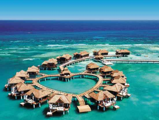 Overwater bungalows at Sandals Royal Caribbean in Montego Bay, Jamaica. | Courtesy of Sandals and Beaches Resorts