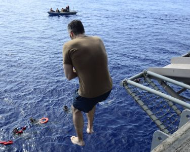 In this May 16, 2020, photo provided by the U.S. Navy, Sailors participate in a swim call on the aircraft carrier USS Dwight D. Eisenhower (CVN 69) in the Persian Gulf. (Mass Communication Specialist 1st Class Tony D. Curtis/U.S. Navy via AP))