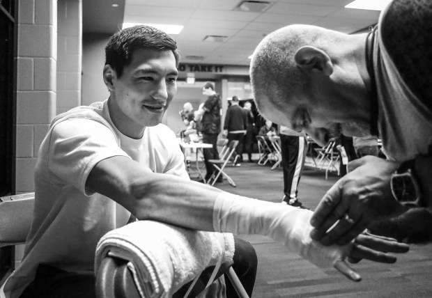 Janibeck Alimkhanuly getting his hands wrapped