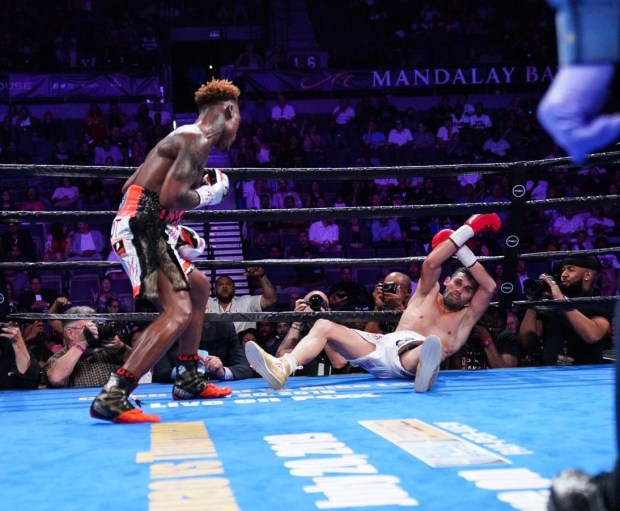 Jermell Charlo drops Jorge Cota with a right hand. Photo: Lina Baker UTHW