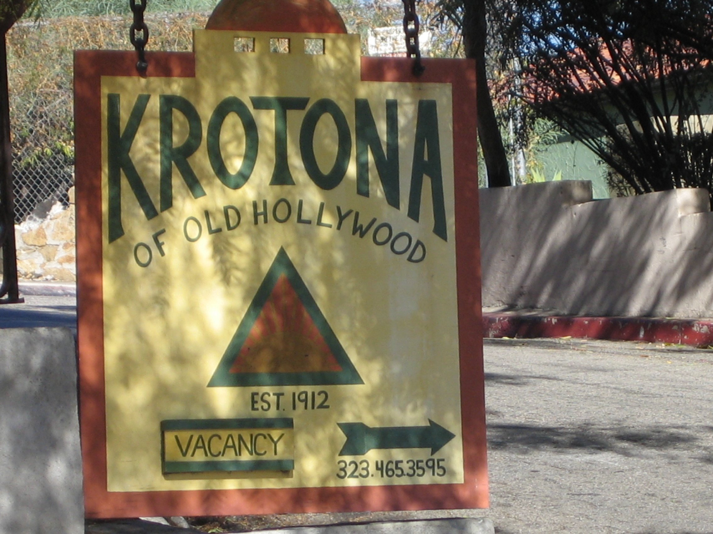 Krotona Apts. Sign with parking lot in background. Photo by Hope Anderson Productions
