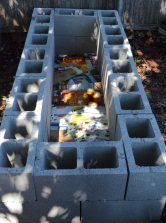 I got a dozen more cinder blocks this morning. Before I finished building the bed, I put some serious about of carton down. No weeds here! ;)