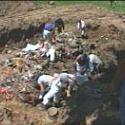 man people unearthing a dirt pit