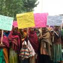 a group of indian women holding signs against police inaction to human trafficking