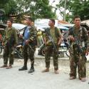 four military men in uniform
