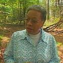 woman standing in wooed area