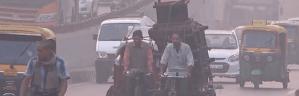 Men on bikes in Delhi