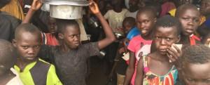 refugee children stand in lines