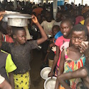 Refugee children in line for food