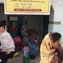 women gather outside clinic