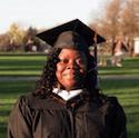 College graduate poses