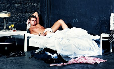 Man Reclining on Bed in Underwear