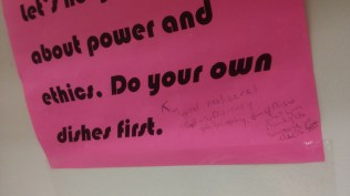 The sign about doing your dishes also comes with other students' critiques of the rule.