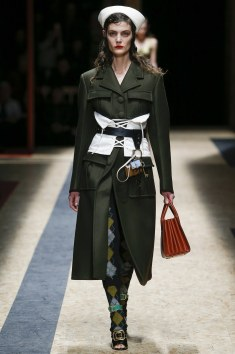 Masculine military jackets contrasted with the feminine corset.