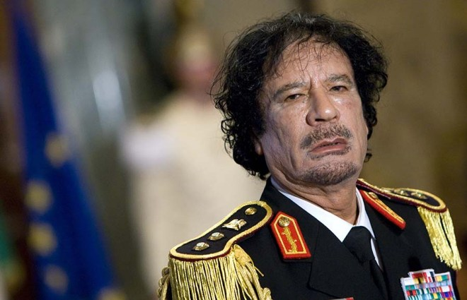 File photo of Libya's leader Gaddafi looking on during a news conference in Rome