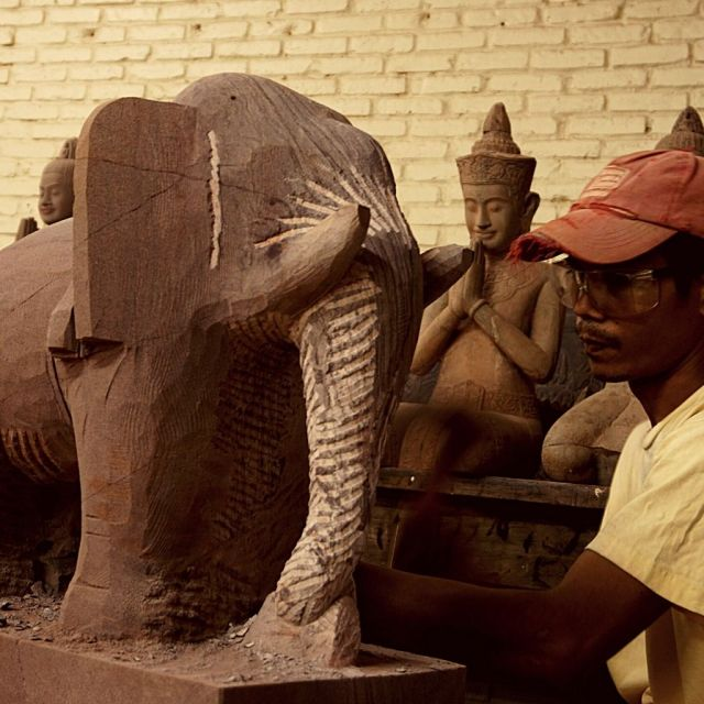 Artisans Angkor - Handworker sculpting an elephant in the wood - Things to do in Siem Reap