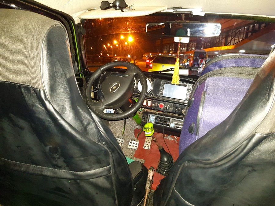 Interior of the taxi - love the scull on the gear stick