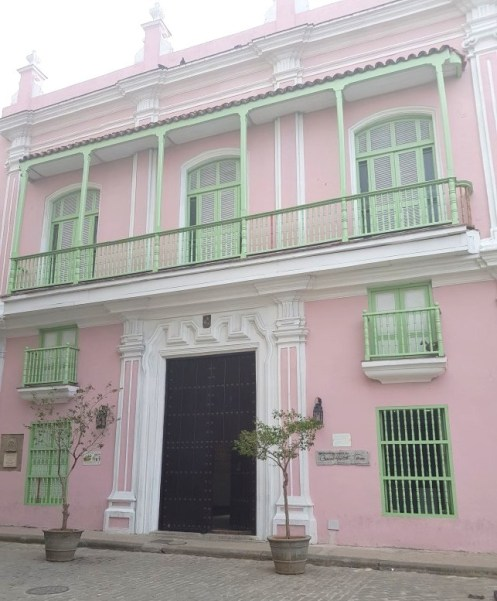 Pink building opposite the monument of the street person